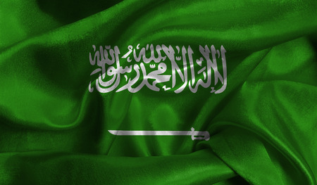 Realistic flag of Saudi Arabia on the wavy surface of fabric. This flag can be used in design. Reklamní fotografie
