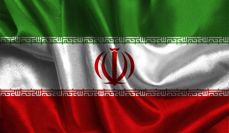 Realistic flag of Iran on the wavy surface of fabric. This flag can be used in design.