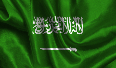 Realistic flag of Saudi Arabia on the wavy surface of fabric. This flag can be used in design. Stock Photo