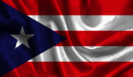 Realistic flag of Puerto Rico on the wavy surface of fabric.