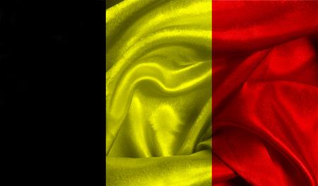 Realistische vlag van België op het golvende oppervlak van weefsel.