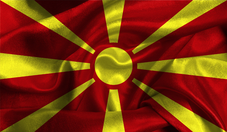 Realistic flag of Macedonia on the wavy surface of fabric.