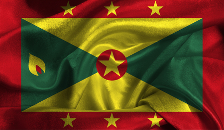 Realistic flag of Grenada on the wavy surface of fabric. Stock Photo