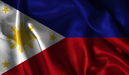 Realistic flag of Philippines on the wavy surface of fabric. Stock Photo