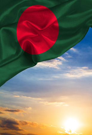 Grunge colorful flag Bangladesh, with copyspace for your text or images against the background of the sunset sky