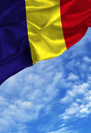 Grunge colorful flag Romania, with copyspace for your text or images against a blue sky with clouds