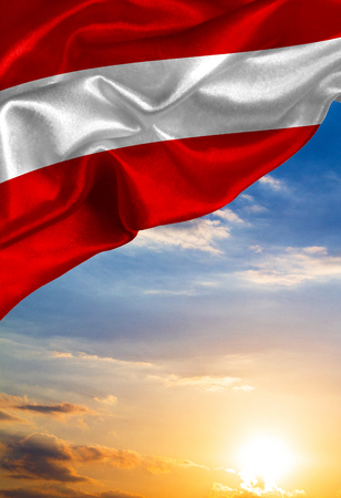 austria flag: Grunge colorful flag Austria, with copyspace for your text or images against the background of the sunset sky
