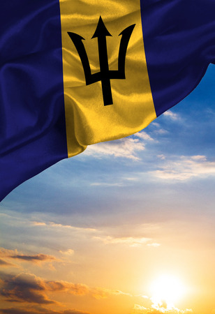 Grunge colorful flag Barbados , with copyspace for your text or images against the background of the sunset sky