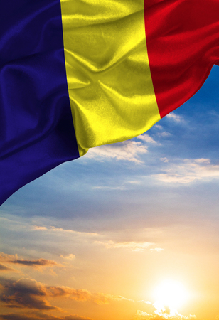 Grunge colorful flag Romania, with copyspace for your text or images against the background of the sunset sky Stock Photo