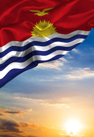 Grunge colorful flag Kiribati, with copyspace for your text or images against the background of the sunset sky