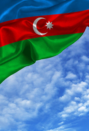 Grunge colorful flag Azerbaijan, with copyspace for your text or images against a blue sky with clouds