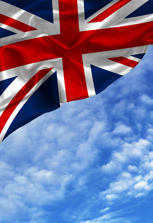Grunge colorful flag United Kingdom, with copyspace for your text or images against a blue sky with clouds