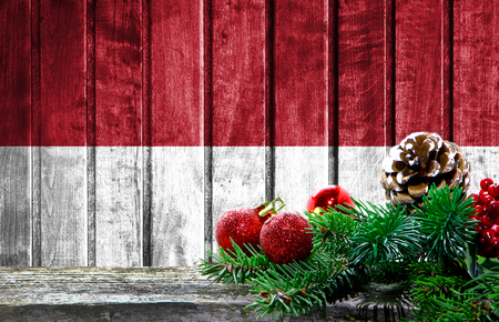 Wooden Christmas background with a flag of Indonesia. There is a place for your text in the photo.