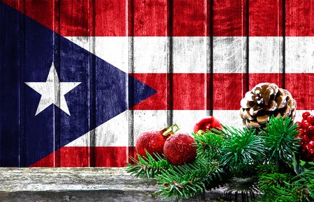 Wooden Christmas background with a flag of Puerto Rico. There is a place for your text in the photo.