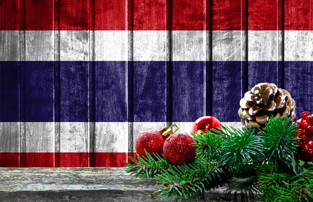 Wooden Christmas background with a flag of Costa Rica. There is a place for your text in the photo.