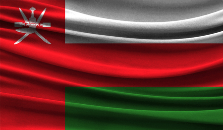 Realistic flag of Oman on the wavy surface of fabric. This flag can be used in design