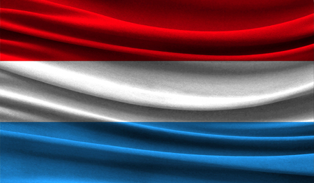 Realistic flag of Luxembourg on the wavy surface of fabric. This flag can be used in design Stock Photo