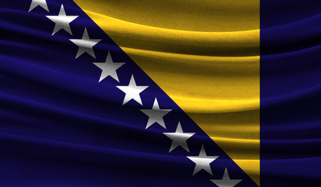 Realistic flag of Bosnia and Herzegovina on the wavy surface of fabric. This flag can be used in design Stock fotó