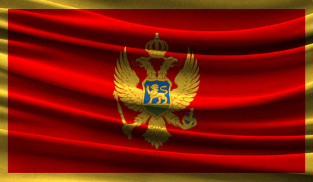Realistic flag of Montenegro on the wavy surface of fabric. This flag can be used in design 写真素材