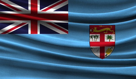 Realistic flag of Fiji on the wavy surface of fabric. This flag can be used in design Stock Photo
