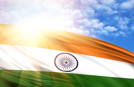 flag of India against the blue sky with sun rays. Stock Photo