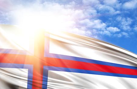 flag of against the blue sky with sun rays. Stock Photo