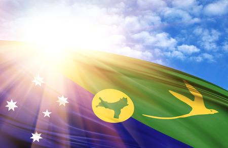flag of Christmas Island against the blue sky with sun rays. Stock Photo