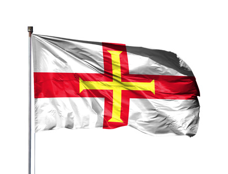 National flag of Guernsey on a flagpole, isolated on white background. 写真素材