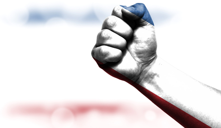 Flag of Crimea drawn on male fist, strength,power,concept of conflict. On a blurred background with a good place for your text.