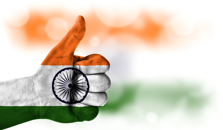 Flag of India drawn on a mans hand with a thumb up, on a blurry background with a good place for text Stock Photo