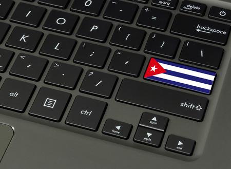 Flag of Cuba on laptop keyboard, close-up. Stock Photo