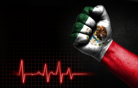 Flag of Mexico painted on male fist, the concept image shows the strength of medicine or politics in countries, photography has a good place for your text.