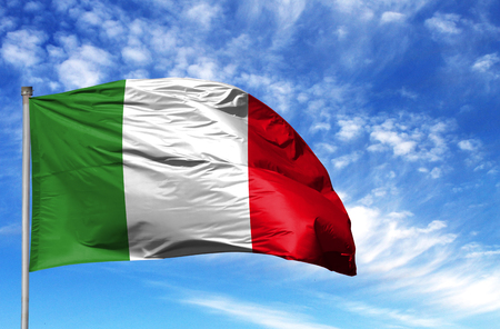 National flag of Italy on a flagpole in front of blue sky. Standard-Bild - 106539660