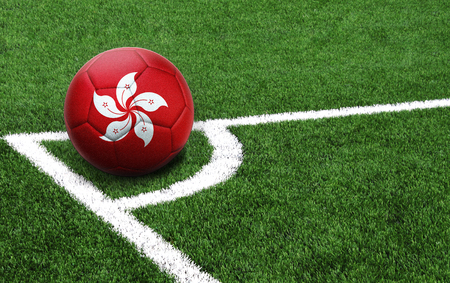 The flag of Hong Kong is depicted on a football, with a good place for your text Archivio Fotografico