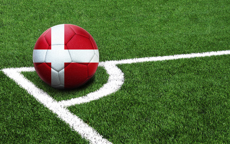 The flag of Denmark is depicted on a football, with a good place for your text