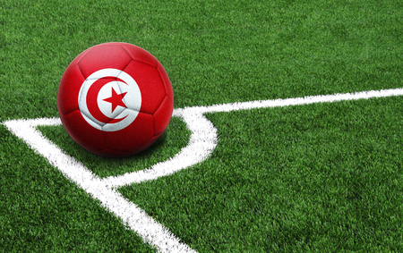 The flag of Tunisia is depicted on a football, with a good place for your text Standard-Bild