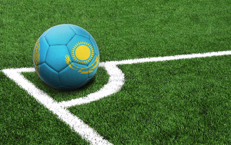 The flag of Kazakhstan is depicted on a football, with a good place for your text 免版税图像