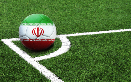 The flag of Iran is depicted on a football, with a good place for your text
