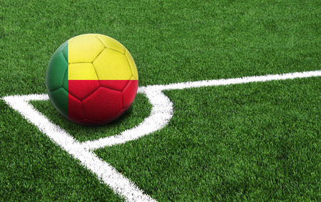 The flag of Benin is depicted on a football, with a good place for your text