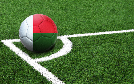 The flag of Madagascar is depicted on a football, with a good place for your text