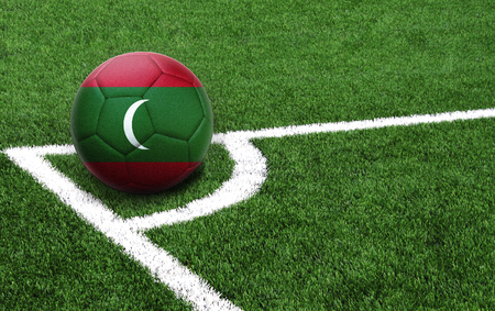 The flag of Maldives is depicted on a football, with a good place for your text
