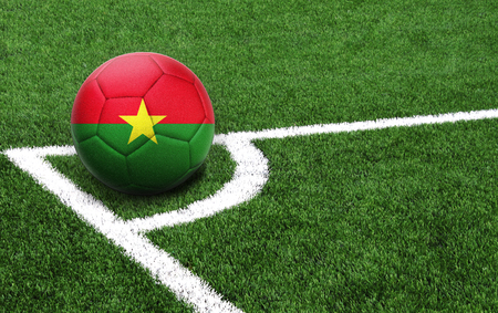 The flag of Burkina Faso is depicted on a football, with a good place for your text Stok Fotoğraf