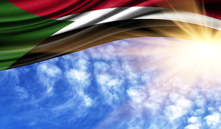the flag of Sudan in the rays of the summer sun, in the sky, photography has a good place for your text.