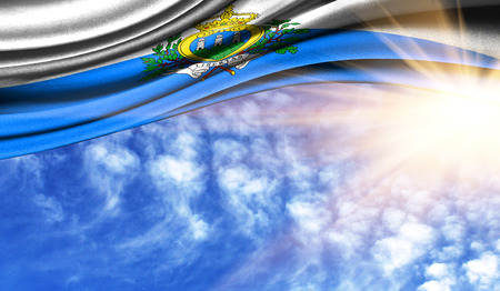 the flag of San marino in the rays of the summer sun, in the sky, photography has a good place for your text.