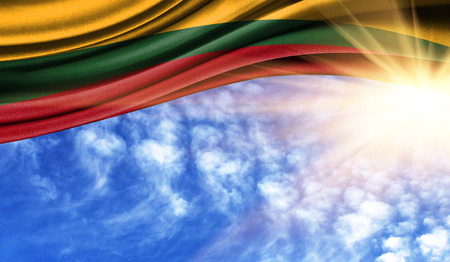 the flag of Lithuania in the rays of the summer sun, in the sky, photography has a good place for your text.