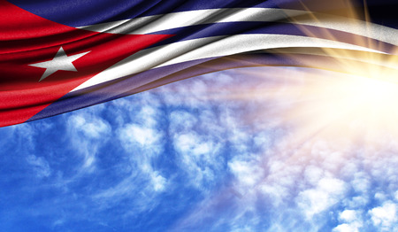the flag of Cuba in the rays of the summer sun, in the sky, photography has a good place for your text.