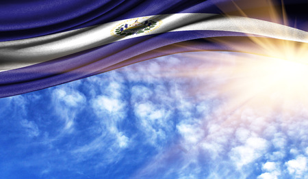 the flag of El Salvador in the rays of the summer sun, in the sky, photography has a good place for your text.