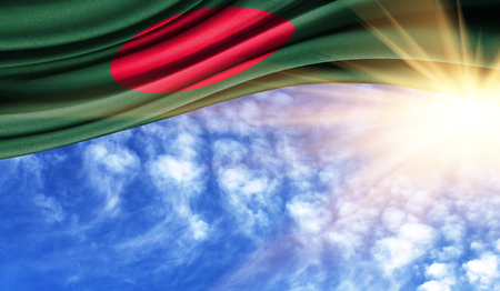 the flag of Bangladesh in the rays of the summer sun, in the sky, photography has a good place for your text.