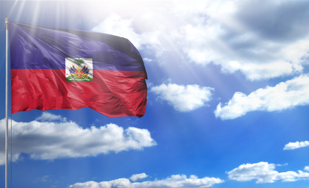 Flag of Haiti on a flagpole against a blue sky, with a good place for your text.