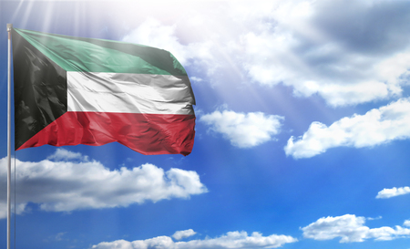 Flag of Kuwait on a flagpole against a blue sky, with a good place for your text.